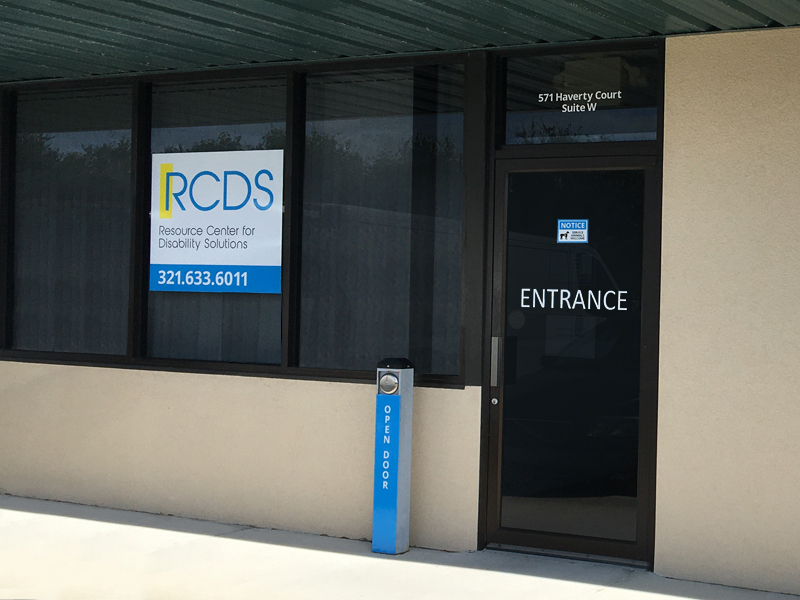 Depicts front of Rockledge building with Entrance door and large RCDS sign with telephone number 321-633-6011, above the door is 571 Haverty Court Suite W