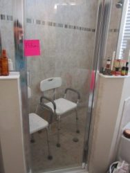 Photo of a new roll-in shower and shower chairs