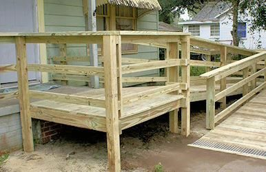 Photo of a wooden ramp with handrails